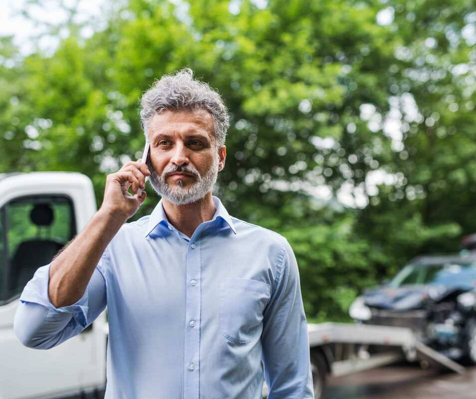 A man calling a Towing wrecker service
